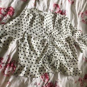 Elodie white ruffle shirt with black polka dots